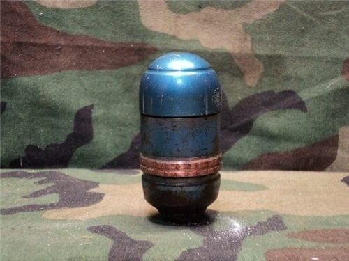 M79/203 Solid tp projectile with blue top and open base.