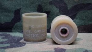 40 mm Unfired, unprimed plastic case, some marked practice m-212.