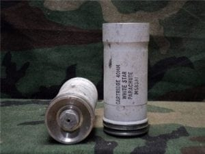 40 mm Fired flare body marked cartridge, 40mm, white star parachute, M583 a.