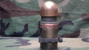 40mm Mark 19 dummy round with fired case, Gold tip and link.