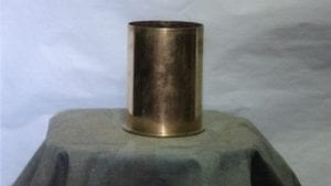 105mm Howitzer polished brass blank case.