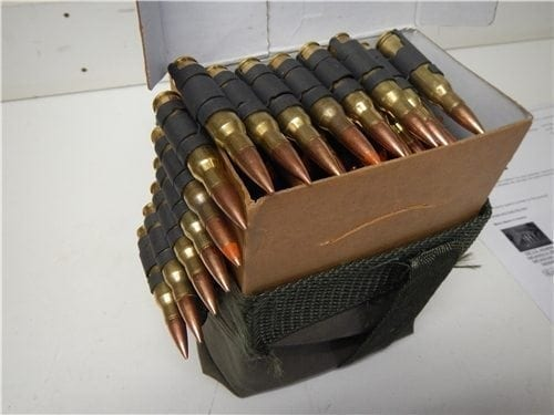 308 ball/Tracer ammo. 4 to 1 in a 100 round linked belt, bandoleer and cardboard box.