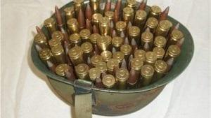 50 cal api ammo. 100 rds in GI helmet